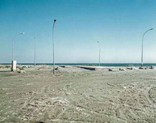 Construction zone on the beach with street lamps