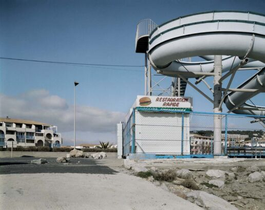 water chute and closed takeaway in a desolate surrounding