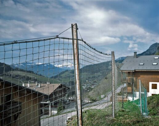 Snow protection fence over mountain village