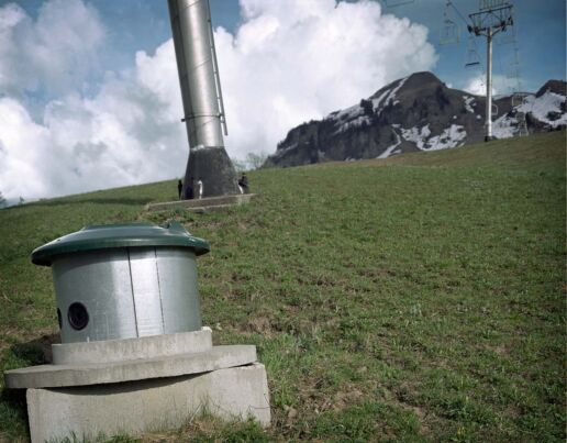 chairlift pillar and snow gun on a slope