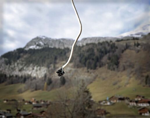 Unused wire coming from the ceiling with a mountain in the background