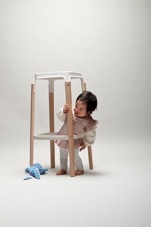 toddler with a bar stool