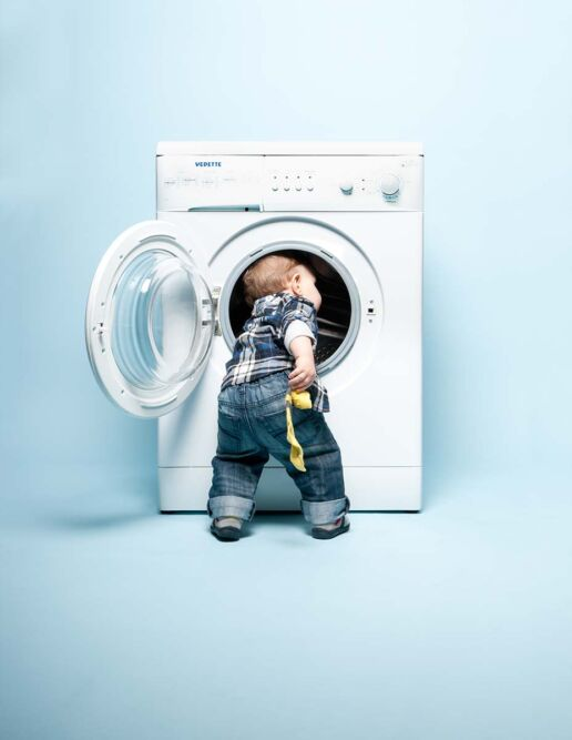 toddler and washing machine