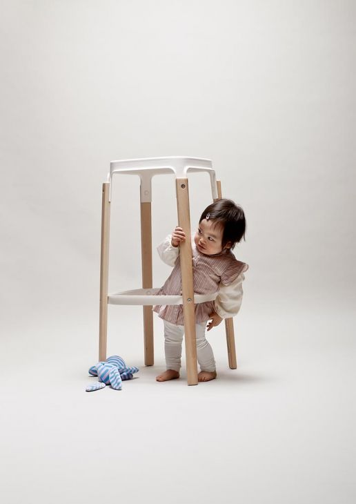 toddler with a bar stool