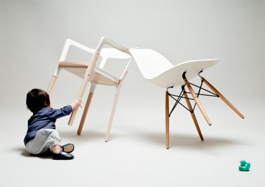 toddler playing with chairs