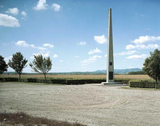 spiky war memorial near a corn field