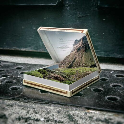 fabulous coastal and mountain landscape boxed in cigarette box